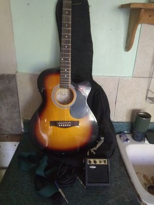 Fender acoustic electric guitar with bag, little amp, strap and chord for Sale in Houston, TX