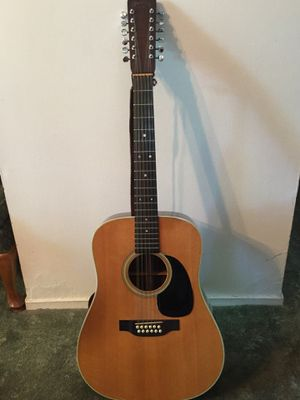 Martin 12 string acoustic guitar with case. Excellent condition. for Sale in Moline, IL