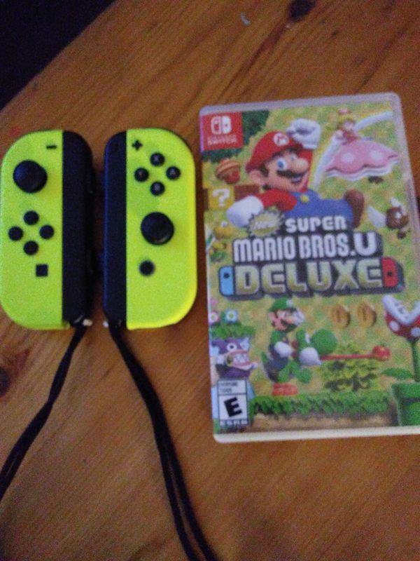 "Neon Yellow Joycons with ""New Super Mario Bros. U DELUXE"" game"