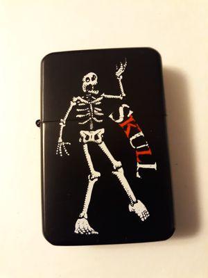 New skeleton skull black windproof oil lighter similar to zippo for Sale in Lancaster, OH