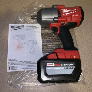 """New Milwaukee 1/2"""" high torque impact wrench with 12.0 battery for Sale in Haverhill, MA"""