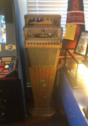 Old school juke box. Plays 45's. Lights up needs some work. Over 50 years old for Sale in Savannah, GA
