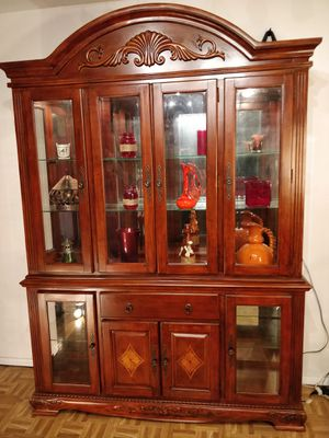 Nice big solid wood chain of cabinet with lights, glass doors and shelves in very good condition, al for Sale in Annandale, VA
