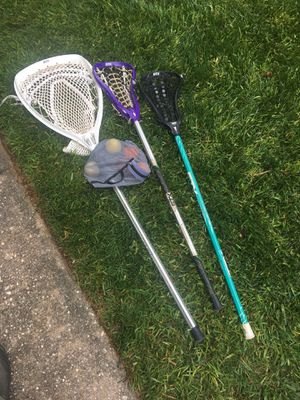 Girls lacrosse goalie stick, tennis racket and Kidd's golf clubs, purple & black sticks sold for Sale in Raleigh, NC