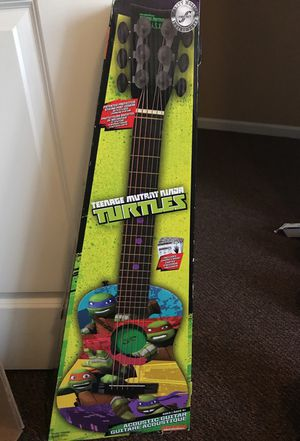 Ninja turtle guitar only used handful of times good condition for Sale in Pittsburgh, PA