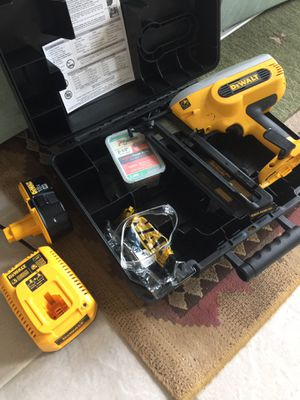 Dewalt nail gun cordless with battery and charger for Sale in Austin, TX
