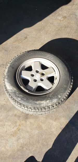 Jeep wheels set of 4 with tires. for Sale in Selma, CA