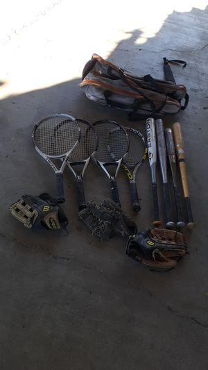 Sporting goods, 4 tennis racquets, Softball bats and gloves for Sale in Las Vegas, NV