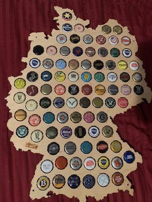 Wooden map of the country of Germany with 80 all different beer bottle caps for Sale in Syosset, NY
