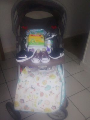 Baby bundle stroller 4 name brand sneakers diapers wipes for.ula brand new blanket for Sale in West Valley City, UT