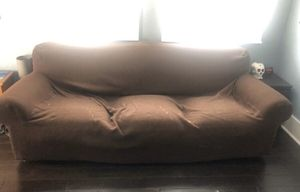 Leather couch with cover for Sale in Tampa, FL