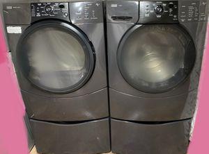 Grey Kenmore washing machine & electric dryer set on pedestals for Sale in Woodstock, GA