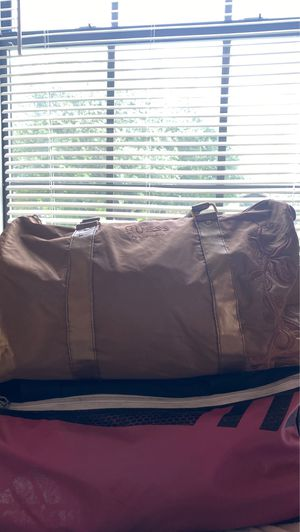 2 duffle bags filled with junior clothing sizes small through medium for Sale in San Antonio, TX
