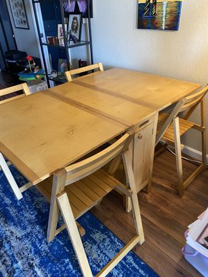 IKEA stowaway dining table 4 chairs. Can seat six for Sale in San Diego, CA