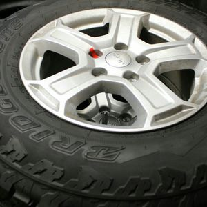 Jeep wrangler Wheels And Tires 245/75/17 for Sale in Redlands, CA