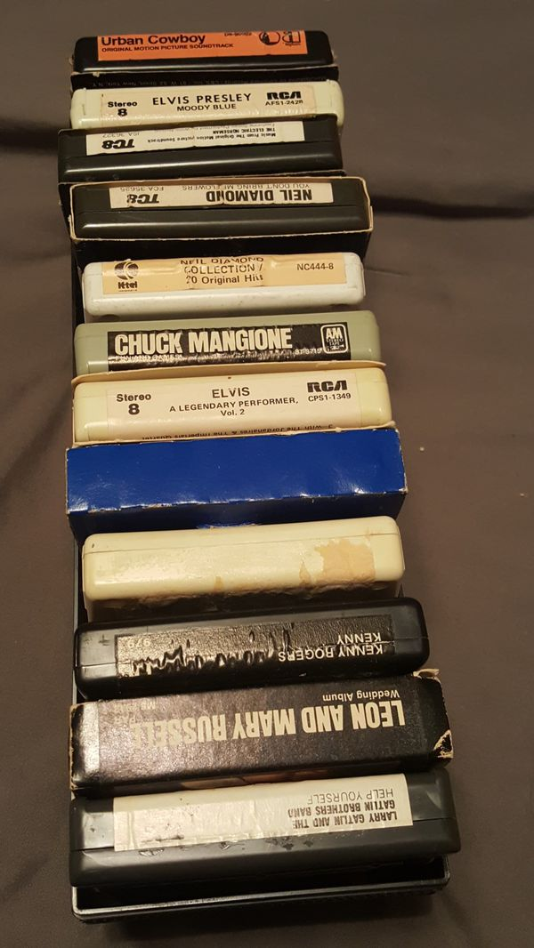 8 track tapes, pink floyd and led zepplin 80s banners