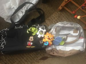 Two Diaper Bags And A Car Seat Toy for Sale in Bowie, MD