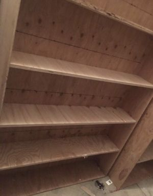 Double sided book shelf for garage - 8 ft tall for Sale in Gresham, OR