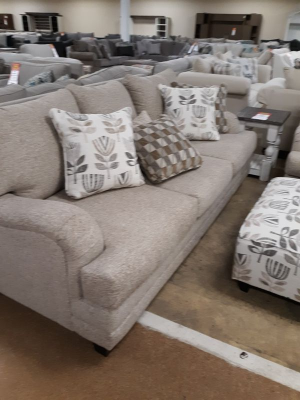 Brand new living room set. Couch, chair and a half, recliner, ottoman, table set