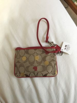 NEW Coach Wristlet RED GOLD NEVER USED tags on! for Sale in Columbus, OH