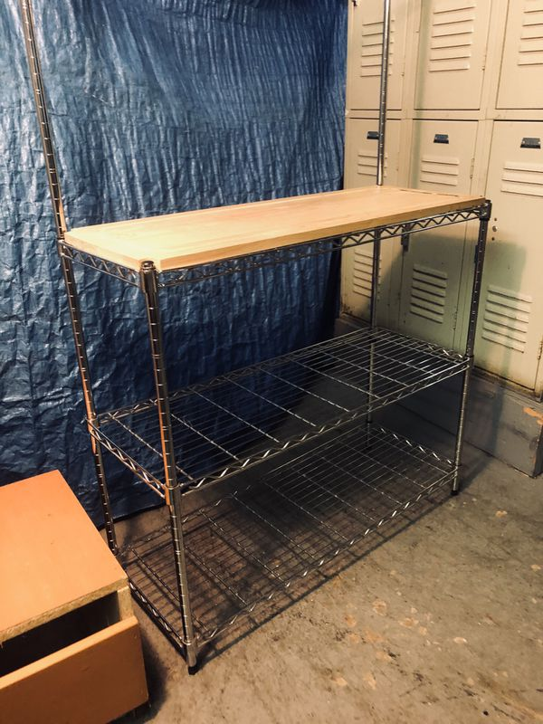 Metal shelving rack with countertop