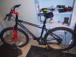 29 inch mountain bike with 2 extra seats and a helmet for Sale in Oakland Park, FL