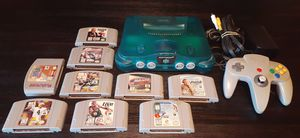 Nintendo n64 ice blue system with 9 games for Sale in Fresno, CA