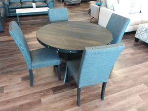 DINING TABLE AND FOUR UPHOLSTERD CHAIRS for Sale in McKinney, TX