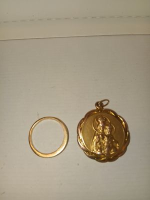 10 karat gold ring with diamonds and a gold pendant for Sale in El Paso, TX