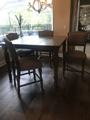 Ashley Furniture counter height table and chairs for Sale in Clearwater, FL
