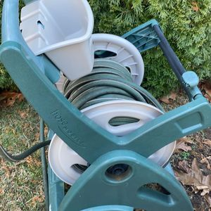 BEST OFFER Was My Dad Before He Died Works Perfect Hose And Holder Had Wheels And Crank To Reel In Hose for Sale in Old Saybrook, CT