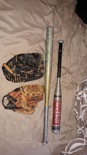 Baseball gloves an bats for Sale in Cleveland, OH