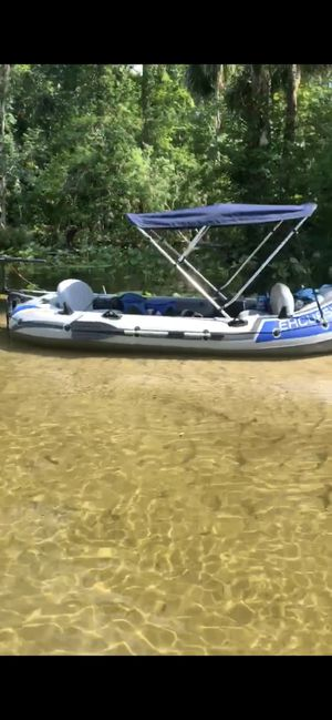 Inflatable boat with top and motor also registered with title in hand for Sale in Orlando, FL