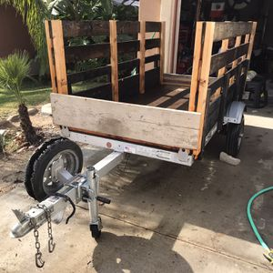 Trailer utility 4 X 8 great for motorcycles or landscaping with tilt up option pink on hand for Sale in Fontana, CA