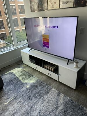 White tv STAND ONLY (11 months old) - (65 inch tv pictures) for Sale in Los Angeles, CA