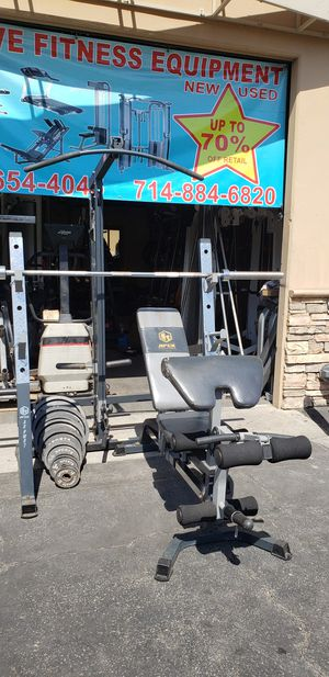 Squat rack/ bench press with Olympic weights for Sale in Anaheim, CA
