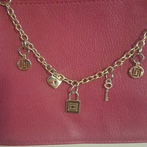 LC Liz Claiborne crossbody bag with charms for Sale in Puyallup, WA