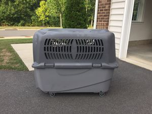 Dog plastic cage, kennel, 3XL for travel with wheels for Sale in South Riding, VA