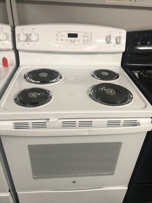 Used GE coil top range. 1 year warranty for Sale in Pinellas Park, FL