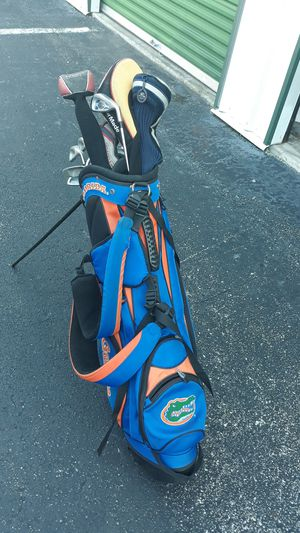 Gators golf bag w/stands & clubs for Sale in Tampa, FL