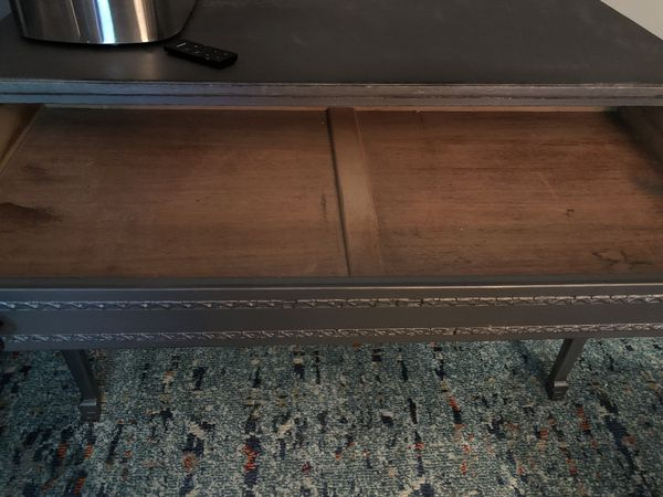 """Very old desk, currently a smoky gray color. One long drawer. I've owned for 42 years and it was used when I got it when """"Thrifting""""!"""