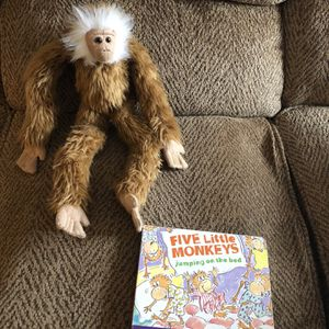 Five little monkeys jumping on the bed board book with plush monkey toy for Sale in St. Peters, MO
