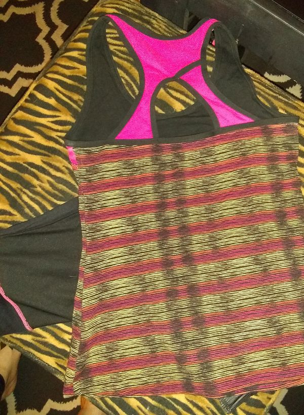 Nice Lot of Women's name brand fitness wear size Medium - Large.