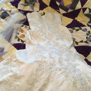 Oleg Cassini Mermaid Ball Gown Tie Bussals Button Down Back Strapless David's Bridal New $1075.00 for Sale in Riverview, FL