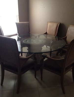 Round glass dining table for Sale in Scottsdale, AZ