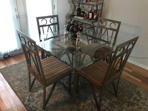 Glass table with four chairs and bakers wine rack. for Sale in Waldorf, MD