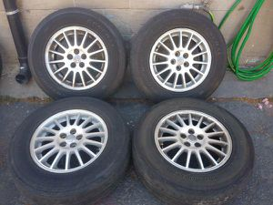 Chrysler town and co 16 inch chrome wheels and tires, 5 on 100mm for Sale in Montebello, CA