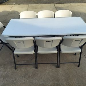 8 Lifetime Adult Folding Chairs And 1 Lifetime 6ft Table for Sale in Upland, CA
