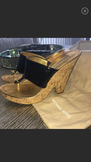 Michael Kors 7.5 patent black cork wedge for Sale in Tampa, FL