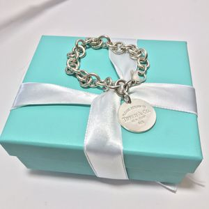 Tiffany&CO Round tag charm bracelet for Sale in MAGNOLIA SQUARE, FL